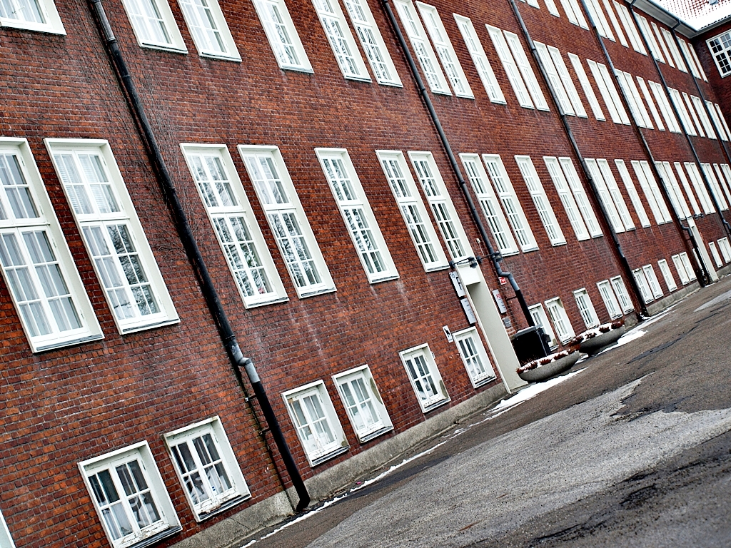 These photographs show the city's former military barracks. Now they are used for offices and storage. Taken on 01.02.14